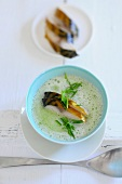 Cream of courgette soup with smoked fish fillet