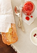Fresh Strawberry Jam, Yogurt and a Baguette; From Above