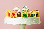 Assorted Filled Cupcakes; Halved to Show Fillings; On a Pedestal Dish