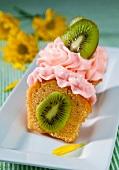 Kiwi Stuffed Cupcake with Strawberry Frosting