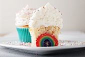 A cupcake with rainbow filling