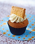 A cupcake topped with an all-butter biscuit