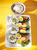 Coalfish steaks with eggs, vegetables and aioli