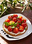 A tomato tart with mascarpone cream and basil