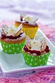 Cupcakes with raspberry jam and cream cheese topping