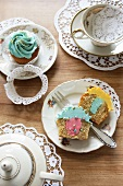 Tea crockery and cupcakes filled with buttercream