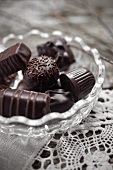 Assorted filled chocolates in a glass bowl