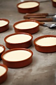 Crema catalana being prepared in individual dishes