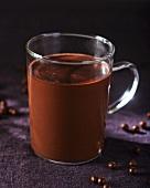 A glass mug of hot chocolate