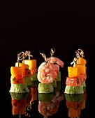 Assorted tapas skewers with mango, salmon, prawns and avocado