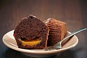 A chocolate muffin filled with orange cream