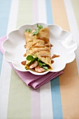 A pancake with prawns and pea shoots