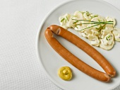 Wiener sausages with potato salad and mustard