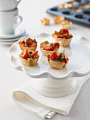 Mini pastry cases filled with strawberries