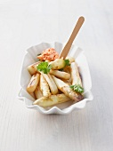 Fried white asparagus with parsley and a tomato dip