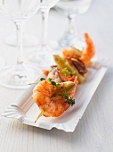 A prawn skewer with asparagus and thyme