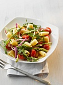 Pasta salad with wild asparagus, onions and cherry tomatoes