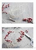 A wreath being made using birch twigs that have been sprayed white and holly berries
