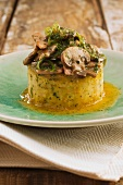 Individual polenta cake topped with mushrooms