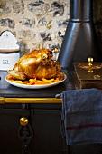 Roast turkey stuffed with mango and foie gras on a sideboard