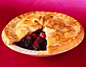 Blackberry and apple pie, with one slice removed