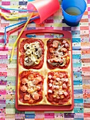 Rectangular child's pizza with a variety of toppings