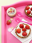 Individual strawberry tarts with cream