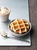 A waffle with coffee and cream