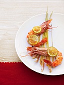 Oven-baked king prawns on lemon grass