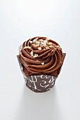 Chocolate cupcake topped with nuts