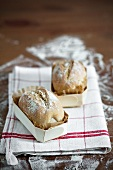 Two miniature loaves of bread