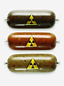Three sausages with radioactivity warning symbols