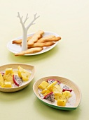 Exotic fruit salad with coconut milk and langue de chat biscuits