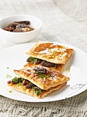 Puff pastry slices with morels