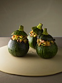 Round courgettes stuffed with shiitake mushrooms