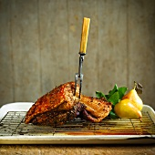 Crispy roasted pork belly with a meat fork