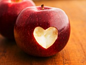 An apple with a heart cut out