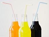 Glass soda bottles with straws
