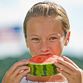 A girl eating a water melon