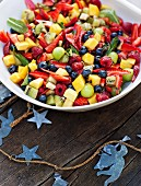 Fruit salad with passion fruit and vanilla syrup for a Christmas picnic (Australia)