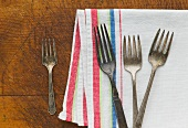 Close up of rusty silver forks and napkin