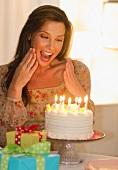 Woman looking at birthday cake