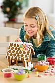 Girl (8--9) making gingerbread house