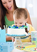 Baby eating birthday cake