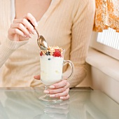 Woman eating breakfast parfait