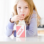 Girl drinking carton of milk