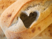 Heart cutout in loaf of bread