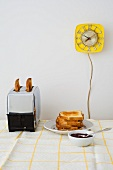 Toast in toaster on breakfast table