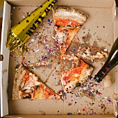 Slices of pizza and confetti in in box