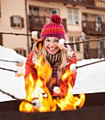 USA, Utah, Salt Lake City, young woman cooking barbecue in winter